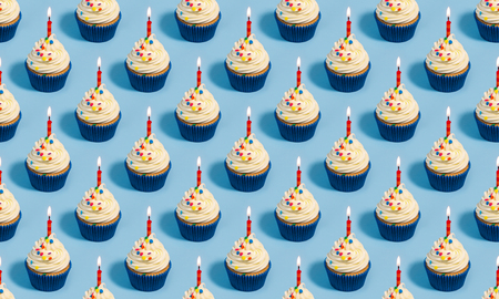 Photo pour Seamless pattern with birthday cupcakes and candles on a blue background - image libre de droit