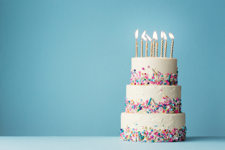 Photo for Birthday cake with three tiers and colorful sprinkles - Royalty Free Image