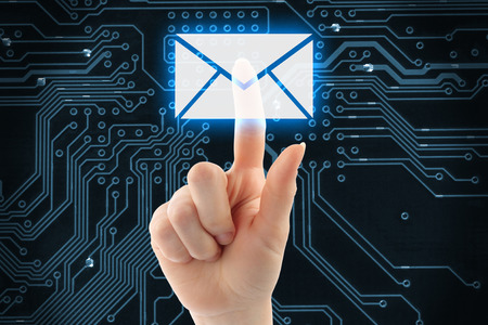 Foto de Hand pushing virtual mail button on digital background - Imagen libre de derechos