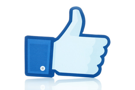 Photo pour KIEV, UKRAINE - JANUARY 10, 2015: Facebook thumbs up sign printed on paper and placed on white background. Facebook is a well-known social networking service. - image libre de droit