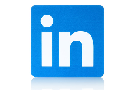 Foto de KIEV, UKRAINE - FEBRUARY 19, 2015: Linkedin logo sign printed on paper and placed on white background. Linkedin is a business social networking service. - Imagen libre de derechos