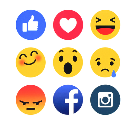 Foto de Kiev, Ukraine - March 8, 2016: New Facebook like button 7 Empathetic Emoji Reactions printed on white paper. Facebook is a well-known social networking service. - Imagen libre de derechos