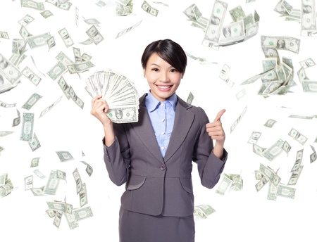 business woman with handful of money giving thumbs up with money rain, asian beauty model