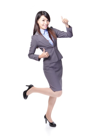 Happy smiling business woman with thumbs up gesture in full length isolated on white background, model is a asian beauty