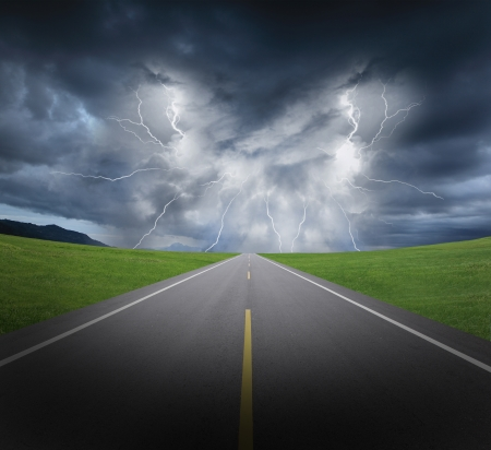 rainstorm clouds and lightning with asphalt road and grass,