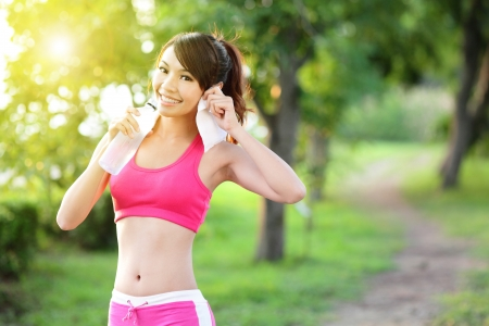 Foto de Healthy woman drinks water, doing sport outdoor, fitness, diet   body care concept - Imagen libre de derechos