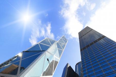 Foto de Modern business buildings with sun and sky, shot in hong kong, asia - Imagen libre de derechos