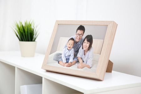 Foto de Happy Family photo on white bookshelf at home - Imagen libre de derechos