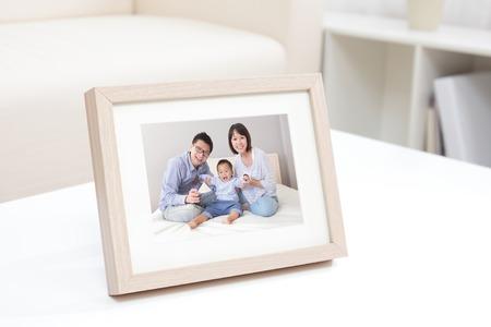 Photo pour Happy Family photo on white bookshelf at home - image libre de droit