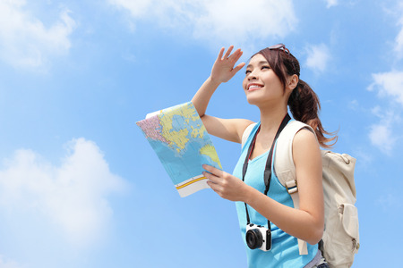 Foto de Happy travel woman look map and look copy space with sky background, asian - Imagen libre de derechos