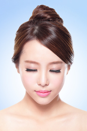 Photo for close up of attractive Skin care woman face relax closed eyes with blue background, asian beauty - Royalty Free Image