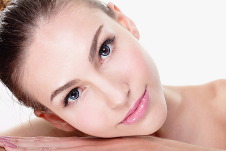 Photo for Close up portrait of beautiful young woman face while lying. Isolated on white background. Skin care or spa concept, caucasian - Royalty Free Image