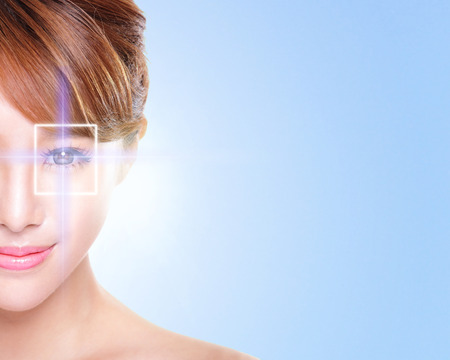 Photo pour Close up portrait of young and beautiful woman eye with the virtual hologram on her eyes, laser medicine and security technology concept, asian - image libre de droit
