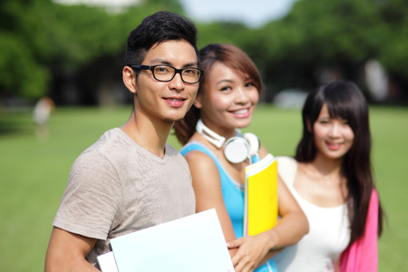 Foto per Happy College students smile to you on campus, asian - Immagine Royalty Free