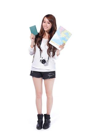 Foto de Happy woman tourist holding passport, camera and map on isolated white background - Imagen libre de derechos