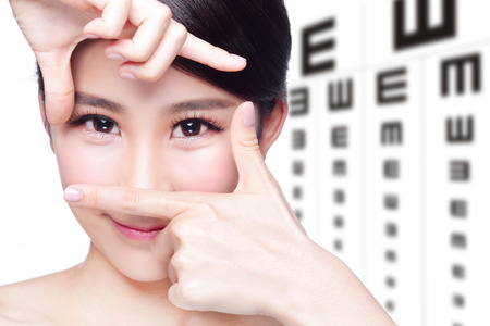 Photo pour beautiful woman eye close up with the background of eye test chart, eye care concept, asian beauty - image libre de droit