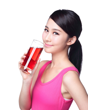 Photo for Young happy woman drink juice ( red cranberry ) isolated on white background, asian - Royalty Free Image