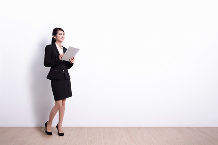 Photo pour business woman using digital tablet pc computer with white wall background, great for your design or text, asian - image libre de droit