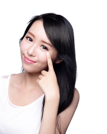 Photo pour Beautiful Woman smile pointing her eye with health long straight hair, asian beauty model - image libre de droit