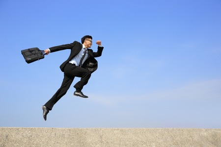 Photo pour business man jump and run with blue sky background, full length, asian male - image libre de droit