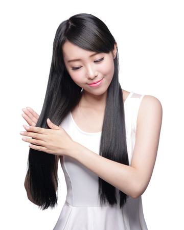 Foto de Beautiful Woman touch her health long straight hair care with smile face, asian beauty model - Imagen libre de derechos