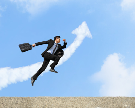 Photo for happy successful business man jump and run with arrow cloud and blue sky background - Royalty Free Image