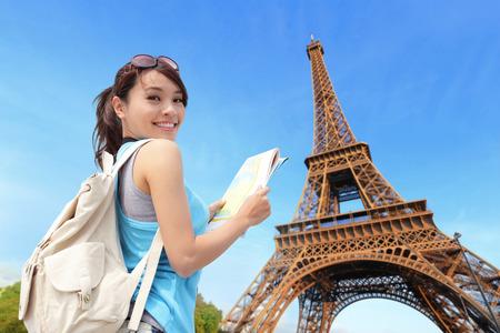Foto de Happy travel woman in Paris with Eiffel Tower and she look map, asian beauty - Imagen libre de derechos