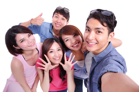 Photo for Selfie - Happy teenagers taking pictures by themselves isolated on white background, asian - Royalty Free Image