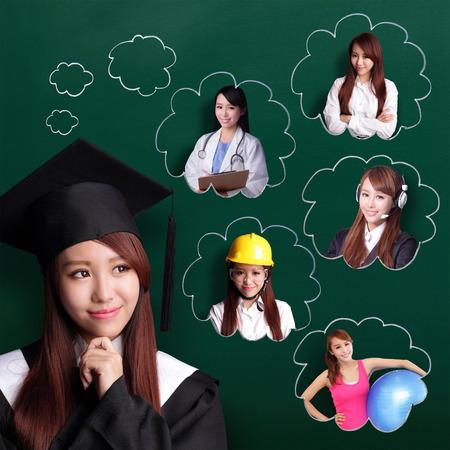 Foto de Smile student woman graduating and think her future and job - Imagen libre de derechos