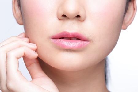 Foto de Close up portrait of young woman with beautiful lips - Imagen libre de derechos