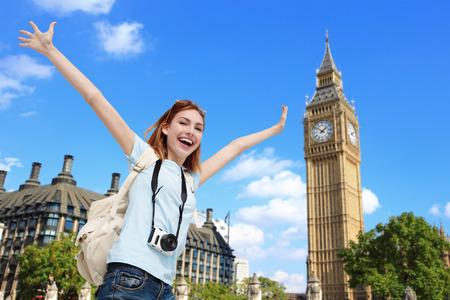 Foto de Happy woman travel in London with Big Ben tower, caucasian beauty - Imagen libre de derechos