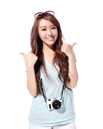 Foto de Happy travel young woman show thumb up isolated over white background, asian - Imagen libre de derechos