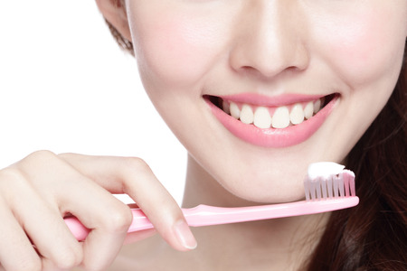 Photo for Close up of Smile woman brush teeth. great for health dental care concept, Isolated over white background. asian - Royalty Free Image