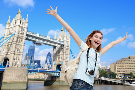 Foto per Happy woman travel in London with tower bridge, and smile to you, caucasian beauty - Immagine Royalty Free