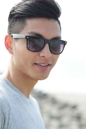 Photo pour Fashion young man with his fashionable sunglasses, asian male - image libre de droit