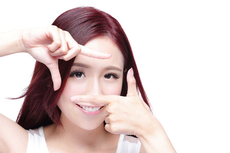 Foto de Woman face and eye care and she making frame with hands, asian woman - Imagen libre de derechos