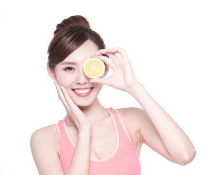 Photo pour Happy Woman show orange benefit to health, asian beauty - image libre de droit