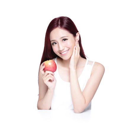 Beauty woman with Apple and charming smile to you, she rests her elbows on white table, asian beauty