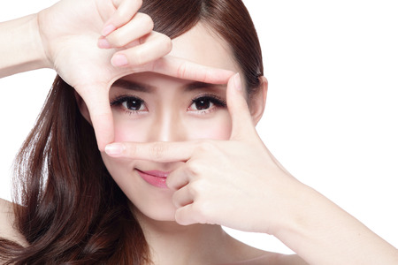 Woman face and eye care and she making frame with hands, asian woman