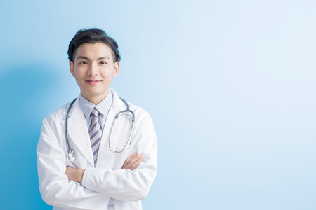 Photo for Male doctor smile to you with isolated blue background,asian - Royalty Free Image
