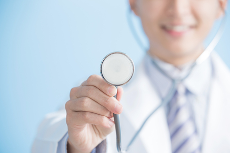 Photo for male doctor show stethoscope to you, asian - Royalty Free Image