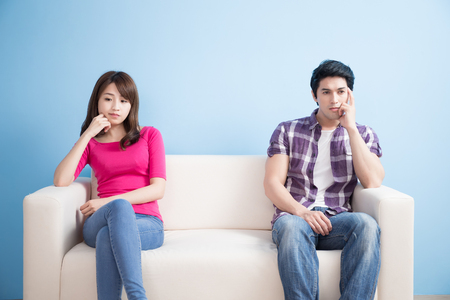 Photo pour young couple feel bad and look somewhere sit on sofa at home - image libre de droit