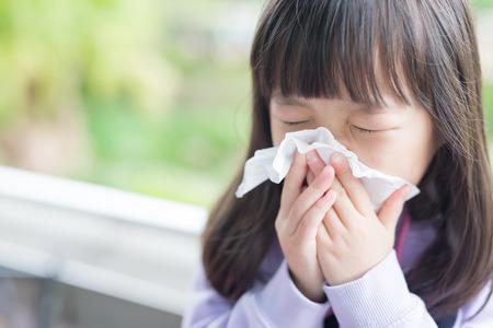 Foto de little girl get cold and blow her nose,  asian - Imagen libre de derechos
