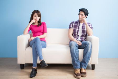Foto de young couple feel bad and look somewhere sit on sofa at home - Imagen libre de derechos