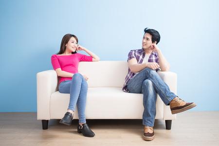 Photo pour young couple look somewhere with blue background - image libre de droit
