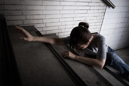 Photo for depressed woman feel upset and lying in underground - Royalty Free Image