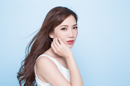 Photo for beauty woman look you on the blue background - Royalty Free Image