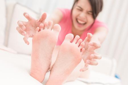 Foto de woman with athlete foot in the room - Imagen libre de derechos