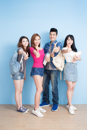 Photo for happy group student show thumb up on the blue background - Royalty Free Image