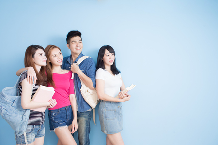 Photo for happy group student look somewhere on the blue background - Royalty Free Image